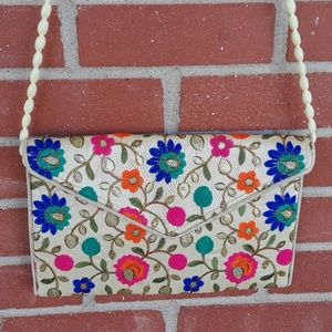 Vintage embroidered convertible crossbody clutch